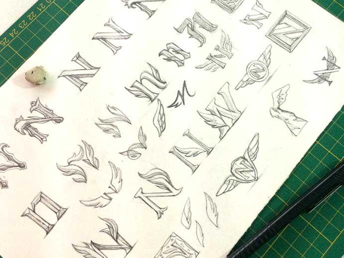 羽をモチーフにしたロゴラフスケッチ